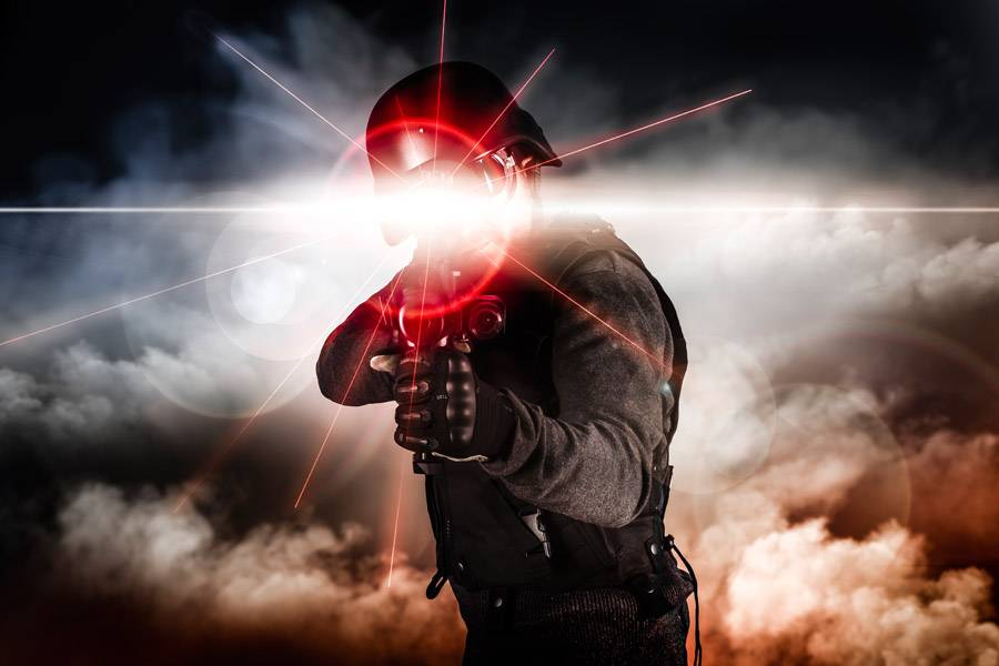 Soldier aiming assault rifle laser sight