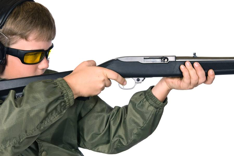 Boy and rifle