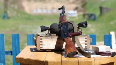Submachine gun on shooting range. Soft focus