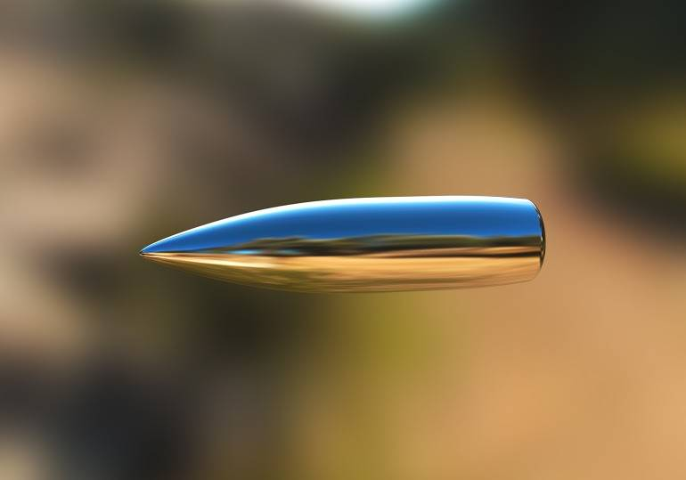 Macro shot of silver bullet caught in flight