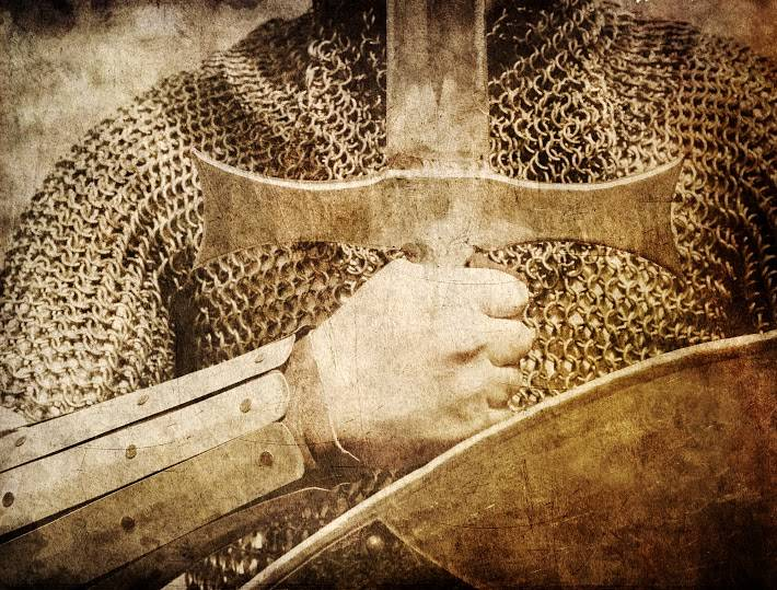 Photo of Knight and sword. Photo in old color image style.