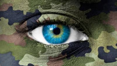 Army camouflage colors on human face