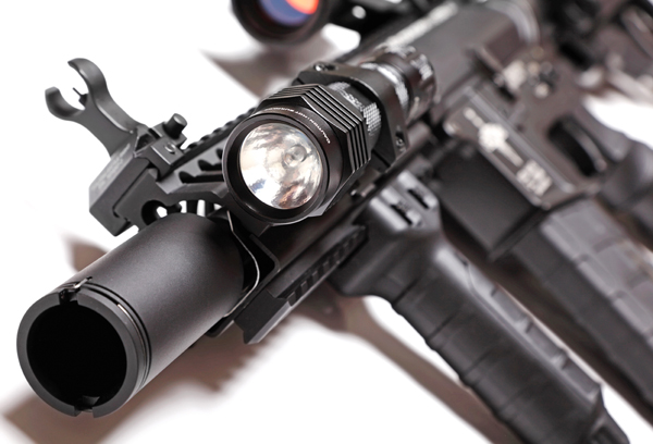 Part of custom build AR-15 tactical carbine with flashlight. Shallow DOF.